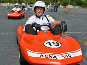 Worshipful Brother Sykes driving his Kena 500 number 19 car in parade